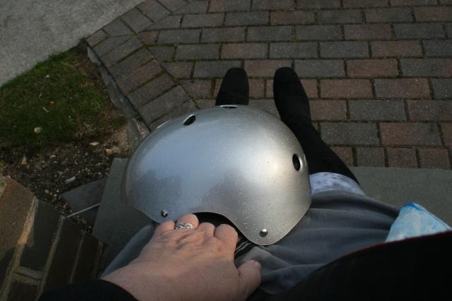 Grey tights, dress, blazer, silver sparkly helmet